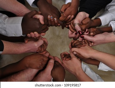 A bunch of different hands in a circle