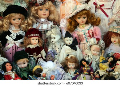 Bunch of different old dolls on market of old things, garage sale