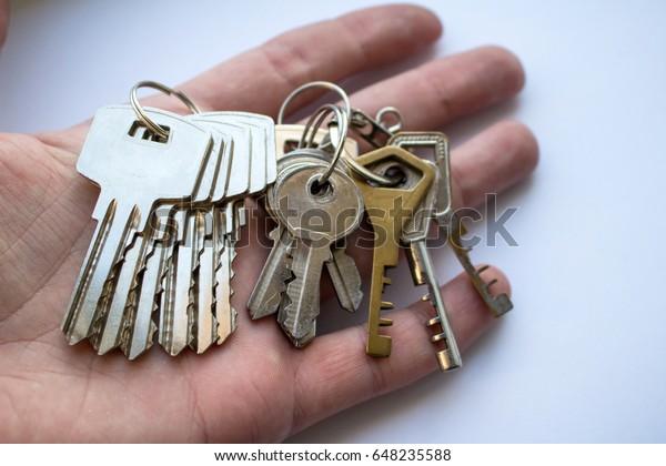 A bunch of door keys on hand
