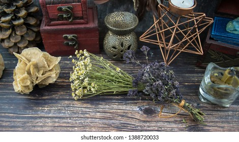 a bunch of dried herbs and natural stones on a wooden background, a casket and a pentagram, Wicca witchcraft