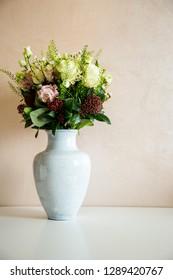 Bunch of elegant flowers in vase as love or Valentines day attribute image