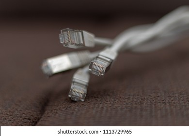 Bunch of Ethernet cables in front of a brown background
