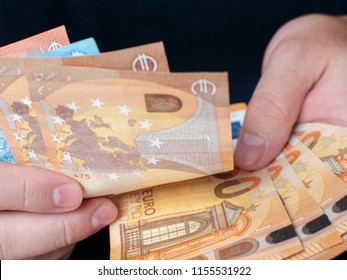 Bunch of Euro in the male hand background