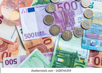 Bunch of european money with coins and bank notes show international finance with euro and europe