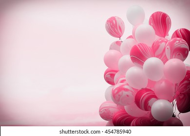 Bunch of fancy pink color balloons floating away in to the sky with vintage filter background