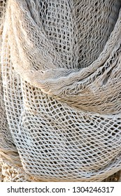 Bunch of fishing trawl net hanging on a trawler boat background