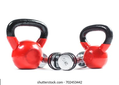 Bunch of fitness training weights isolated on white. Dumbbells, kettlebell.