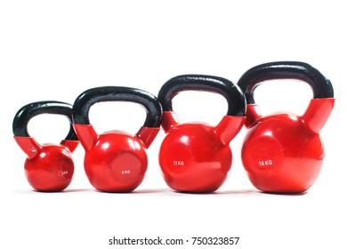 Bunch of fitness training weights isolated on white background. Kettlebell.