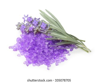 Bunch of flowering violet lavender herb and sea salt isolated on white background.