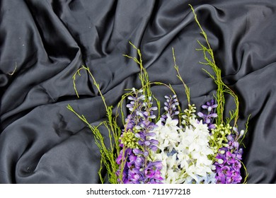 bunch of flowers on black fabric