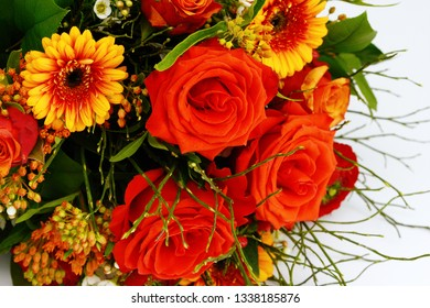 bunch of flowers with red roses