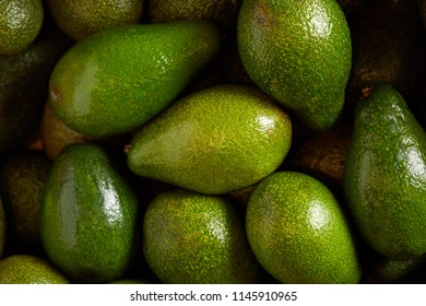 Bunch of fresh avocados fruits in the organic food market