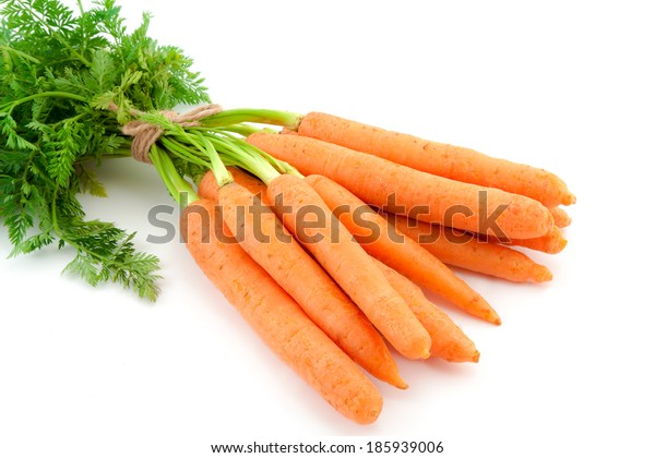 Bunch of fresh baby carrots isolated over white background.