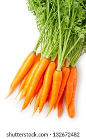 Bunch of fresh carrots with green tops. Isolated on a white.