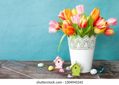 Bunch of fresh colorful tulips with easter decorations