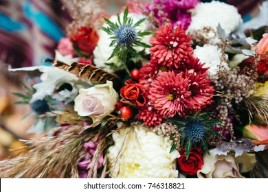 Bunch of fresh flowers in marsala colors. Boho style