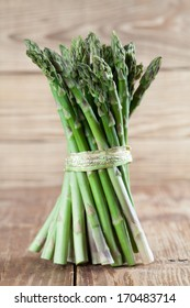 Bunch of fresh green asparagus on wooden background