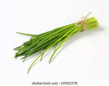 Bunch of fresh green chive on white background