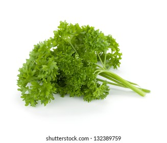 Bunch of fresh green curly parsley. Isolated on white background