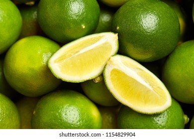 Bunch of fresh green limes in the organic food market