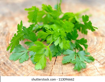 Bunch of fresh green parsley on a wooden background