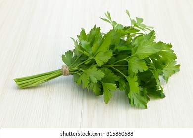 Bunch of fresh green parsley on a wooden surface