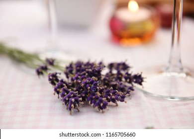 Bunch of fresh lavender and a burning candle