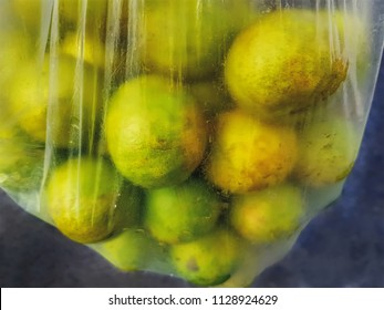 Bunch of Fresh Limes in Clear Plastic Bag