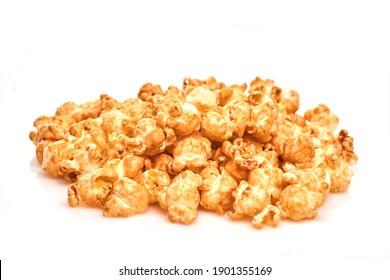 Bunch of fresh popcorn closeup on white. Caramel sweet popcorn. Top view.