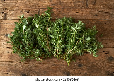 bunch of fresh portulaca sativa on a wooden table