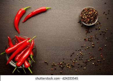 bunch fresh raw red hot chilli pepper and bell pepper on a wooden background