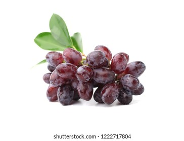 Bunch of fresh red grapes isolated on white background.