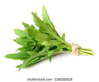bunch of fresh rocket leaves isolated on white background