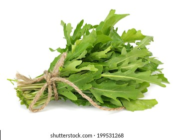 Bunch of fresh rucola on a white background