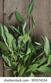 A bunch of fresh sage on an on wooden background, top view