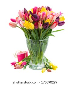 bunch of fresh spring colorful  tulips  in vase  isolated on white background