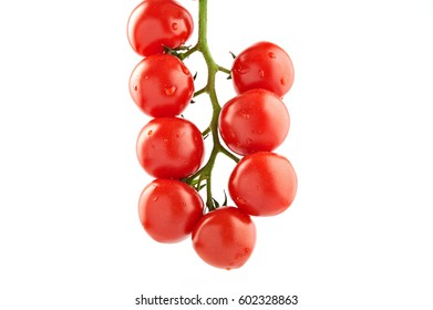 Bunch of fresh tomatoes with water drops. Top view isolated on white background.