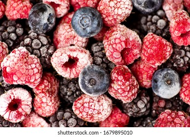 Bunch of frozen berry fruit making a background pattern