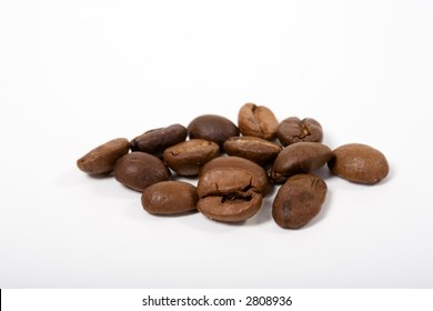 Bunch of good smelling Espressobeans. On white background.