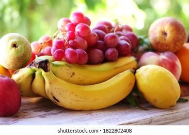 bunch of grapes, bananas and citric fruits
