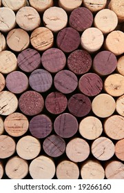 Bunch of grapes shape made of corks. Oenological background.