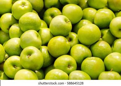 Bunch of green apples in supermarket