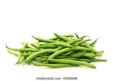 bunch of green beans on a white background