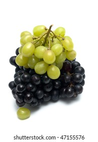 bunch of green and black grapes isolated on white
