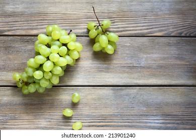 bunch green grapes on wooden background, , food closeup