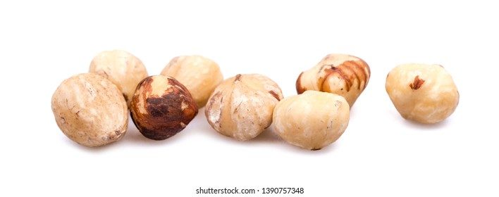 A bunch of hazelnuts on a white background. Raw hazelnuts isolated over white background