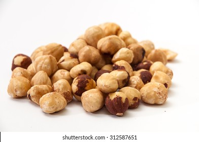 A bunch of hazelnuts on a white background. Raw hazelnuts isolated over white background.
