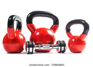 Bunch of heavy training weights, dumbbell, kettlebell. Weight training equipment, isolated on white.