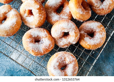 Bunch of homemade donuts with powdered sugar