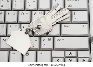 Bunch of keys on key ring on laptop keyboard background